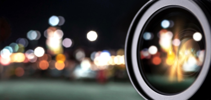 dslr photography lens. camera lens isolated with bokeh lights.